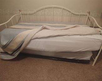 Daybed showing popup trundle with mattress.  Makes a king size bed with trundle is popped up.