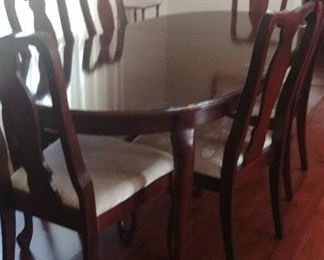 Cherry dining table with eight chairs.  (6 shown)
