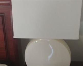 Contemporary off white ceramic lamps with rectangular shades.