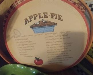Apple pie lined basket with wood lid and recipe on top with handles to carry it.
