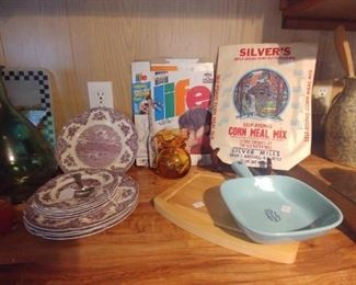 Mix of vintage things and contemporary glass duck cutting board.