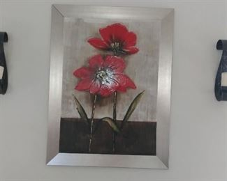 Contemporary wall art and a pair of candle holders.