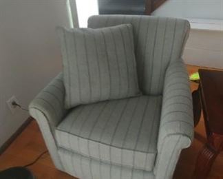 New grey with blue pinstripe swivel chair made by England Furniture Company.