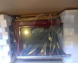 New in the Box Kitchenaide Countertop Convection Oven and Toaster Oven.   Red color.