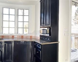microwave  dishwasher  granite cabinets drawers
