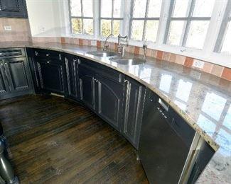 sink  dishwasher  granite faucet black cabinets  drawers