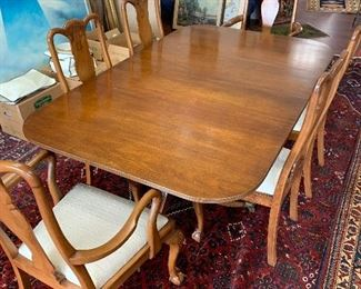 """Late 19th century George III Style Mahogany double pedestal dining table with 2 extra leaves.  Rectangular top (3/8th thick) with rounded corners and reeded edge, surmounting two late 19th century pedestals, each with 3 reeded saber legs ending in brass lion paw feet raised on brass castors; tapering column supports have ring turnings.  H: 29"""", L: 71"""" without leaves; W: 45"""" Condition: Good.  Provenance: purchased from Krupsaw's Antiques, Washington, DC.  $2200"""
