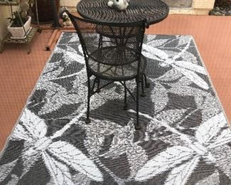 New indoor/out door rug with table and 2 chairs