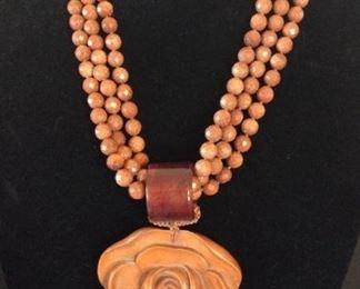 MLC006 Three Strand Goldstones & Hand Carved Wooden Flower Necklace