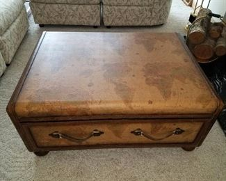"World Map Suitcase Coffee Table with one drawer and leather handles. 38"" x 27"" x 17"" $60."