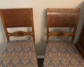 2 of the 10 chairs to the dining room set