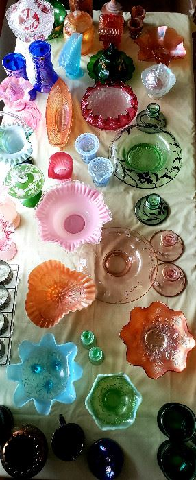 "Many lovely pieces of glassware including ""end of day"", Carnival, vintage glass set, etc."