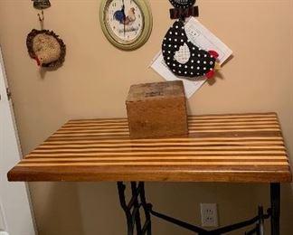 Butcher block top on metal sewing machine treadle base