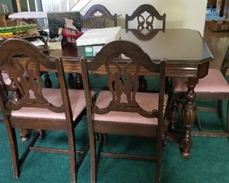 $195. Item #102. Dining Table with 6 chairs, one of which is an arm chair. Some light scratches, good condition. 61 long x 42 wide x 30 high.