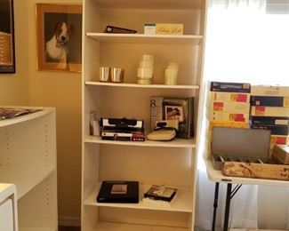 $25 - White Bookcase. Does not include contents.
