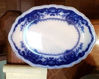 "$25 - Item #8: Flow Blue platter, approx. 16"" long. Has 1/2"" chip. Johnson Bros."