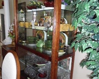 Howard Miller.  Large Curio Cabinet. Full Glass front sliding panel.