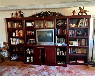 Adjustable Entertainment Center ($300), BOOKS galore, Mexican Pottery, Beer-steins, Medicine Jars