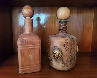 "1506: 2 Leather Wrapped Decanters Approx 9"" tall"
