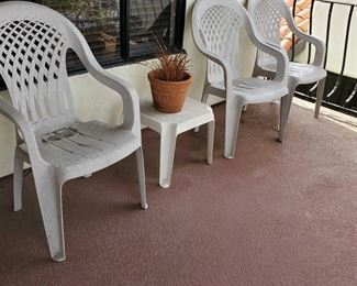 3 White Plastic Chairs, End Table and Pottery 3 White Plastic Patio furniture and Pot6