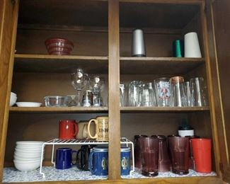 4 Cupboards Full of Glassware and More! Items include plastic cups, glass cups, glass bowls, glass plates, cookie jars, tea box and more!