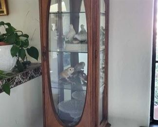 """Wooden Display Cabinet with Figurines, Glass Dish and Basket Measures approx 21"""" x 14"""" x 71"""" Cabinet is fastened to wall"""