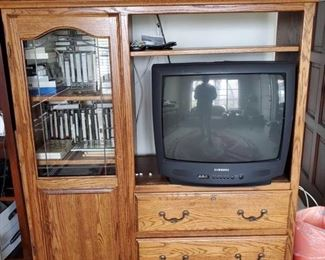 """Entertainment Center, TV, VHS's, CD Player and more! Includes February 7th, 1929 COA newspaper, records, Kodak Carousel Projector 5600 and more! Entertainment center measures approx 53""""x17""""x55"""""""