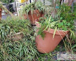 "3 Planters Measurements range from 18"" x 14 - 24"" x 21"""