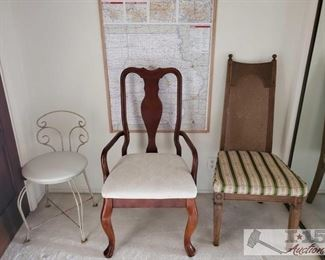 One metal chair, wooden chair with arm rests, one wicker back chair.