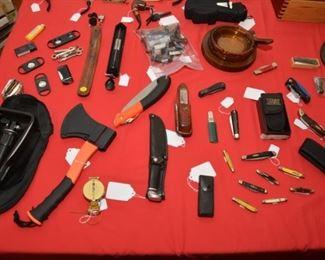 folding trench shovel, survival hatchet, compass, and various pocketknives