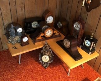 Nice selection of antique/vintage clocks displayed on cool mid-century modern corner table.  This sale offers a great selection of clocks and mid-century/retro items .