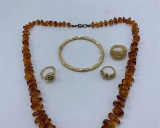 Gold Rings, Bracelet, and Amber Necklace
