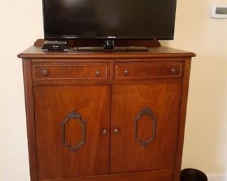 Renaissance style chest of drawers and TV