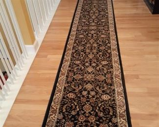 One of several very long Oriental style runners.  One is 18 feet, two are 20 feet