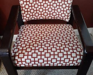 One of a pair of armchairs on rollers in office