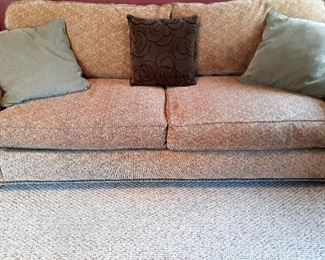 One of a PAIR of brown toned two cushion sofas