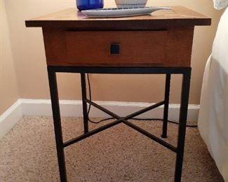 checkerboard small table with wrought iron legs