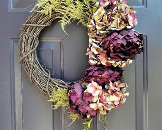 One of a pair of matching wreaths with purple flowers