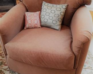 One of a pair of swivel barrel chairs