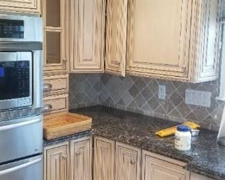 Custom cabinetry, Sub-Zero fridge, Fisher Paykel dishwasher, sink, disposal, matching peninsula with cooktop and all granite $6000 for all. Does not include Thermador oven, warming tray & microwave