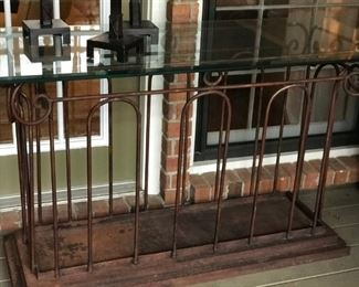 "Glass and iron sofa table 56""x 24""x 32 ½"" tall. $175"