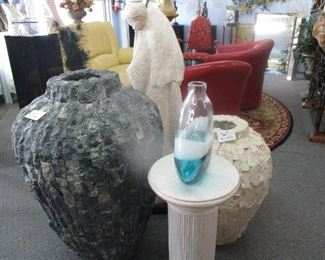 Both vases are handcrafted from stone