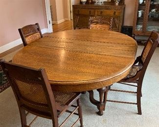 """#2Antique dining table with 4 cane chairs, 3 leaves and pads 48""""-78""""x48""""x28"""" $150.00  SOLD"""