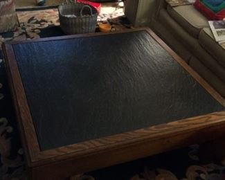 "Wood and slate coffee table; 42"" x 42"" x 13"" high; slate middle comes out; good condition and durable; $125"