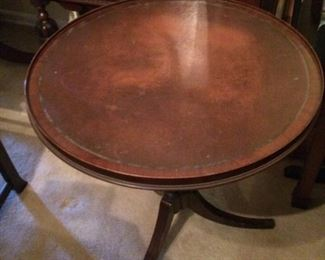 "Antique round table; 25"" x 29""; some wear on the top, nice detail around the edge; $100."