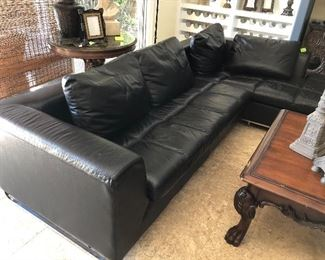 Black Sofa  (AS IS)  $800.00  -  2 piece  -  Approx. 9.5' length and chaise being 7'  -  Tiny puncture holes on back from owner's cat
