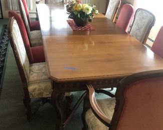 "Absolutely beautiful antique dining set - circa 1920!!!  Walnut - has carved skirt and legs.    Extra leaves - not in the current display - are stored in custom wood storage rack.  As displayed it measures 108"".  With additional leaves measures 144"".  Closed measures 78"".  Has 8 chairs all in very good condition.  Includes heavy cloth table top protector.  Buy it now $2000."