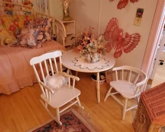 Adorable white table with a chair and a rocker