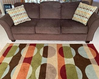 Comfortable sofa w/pillows - area rug also for sale