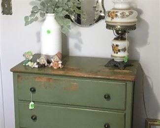 4 drawer distressed green chest with bun feet.